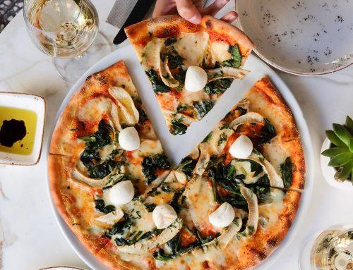 Thin crust spinach and mozzarella pizza